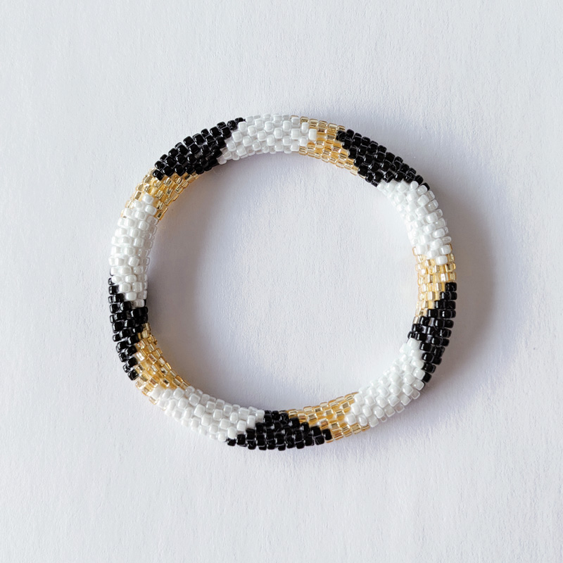 Bracelet népalais blanc noir et doré - Maia et Zoé